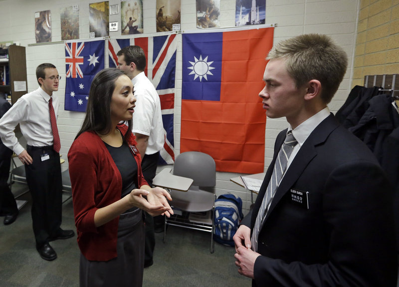 Mormon missionaries Mikaela Merrill, 19, left, and Harrison Surdu practice their Mandarin Chinese during a class at the Missionary Training Center in Provo, Utah.