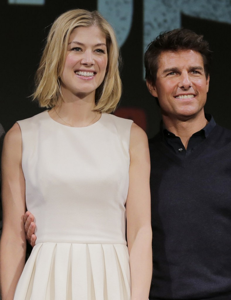 "Tom Cruise and British actress Rosamund Pike promote their film ""Jack Reacher"" last week. Cruise was not at home when his house was ""swatted"" on Thursday."