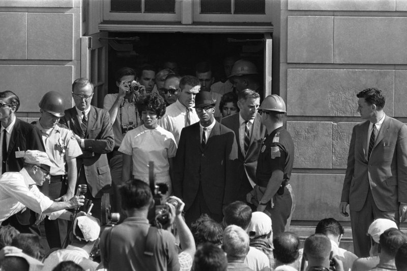 Vivian Malone and James Hood speak with reporters after registering at the University of Alabama in 1963.