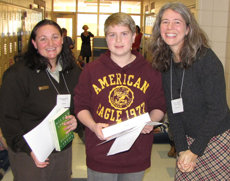 Nick Prato, a seventh-grader at Frank Harrison Middle School in Yarmouth, won the top prize in a statewide Silent Spring essay contest. With him are Karrie Schwaab, Rachel Carson National Wildlife Refuge, left, and Suzanne Kahn Eder, Wells Reserve at Laudholm. Other top winners were Drake Janes of Adams School in Castine, and Crystal Bell and Samantha McIntyre, both of Holbrook Middle School in Holden. The winners were selected from 257 essays, submitted from 24 schools across the state. Nineteen honorable mentions also were awarded.