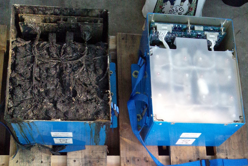 A photo provided by the Japan Transport Safety Board shows the distorted main lithium-ion battery, left, and an undamaged auxiliary battery of the All Nippon Airways' Boeing 787 which made an emergency landing last week in Japan.
