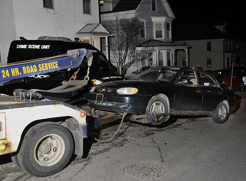 Police towed a car from the driveway of the 266 West Concord St. for analysis