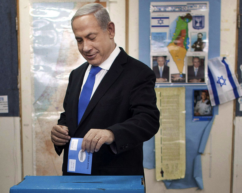 Israeli Prime Minister Benjamin Netanyahu casts his ballot at a polling station in Jerusalem on Tuesday.