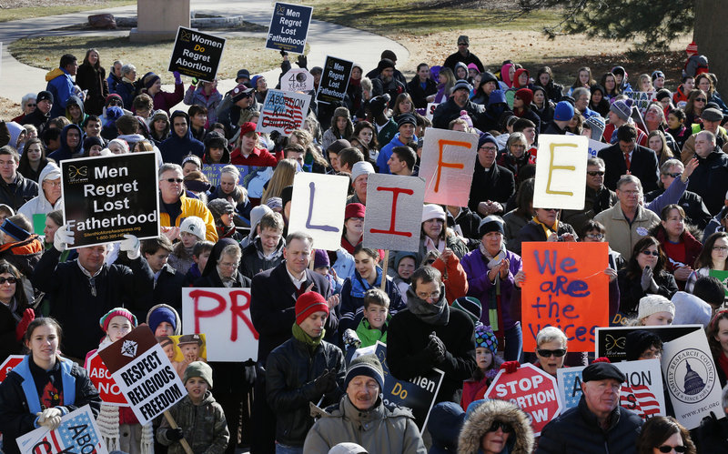 """Abortion foes rally Tuesday outside the Statehouse in Topeka, Kan. Gov. Sam Brownback told the 1,000 or so marchers: """"There's joy in what you're doing and keep it up."""""""