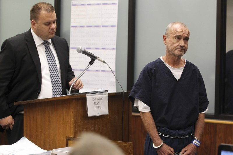 """Peter Robbins, right, the voice of Charlie Brown in """"Peanuts,"""" appears in court on charges of stalking and threatening."""