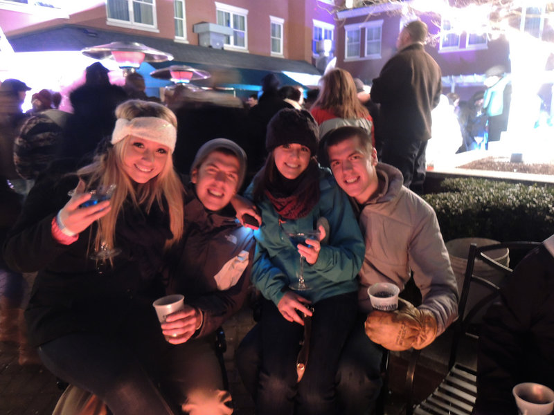 Brooke Taylor, who recently moved here from Colorado, snagged a seat to enjoy her beverage fireside with Portland natives and fellow revelers Andrew Baxter, Tori Ripley and Morgan Baxter.