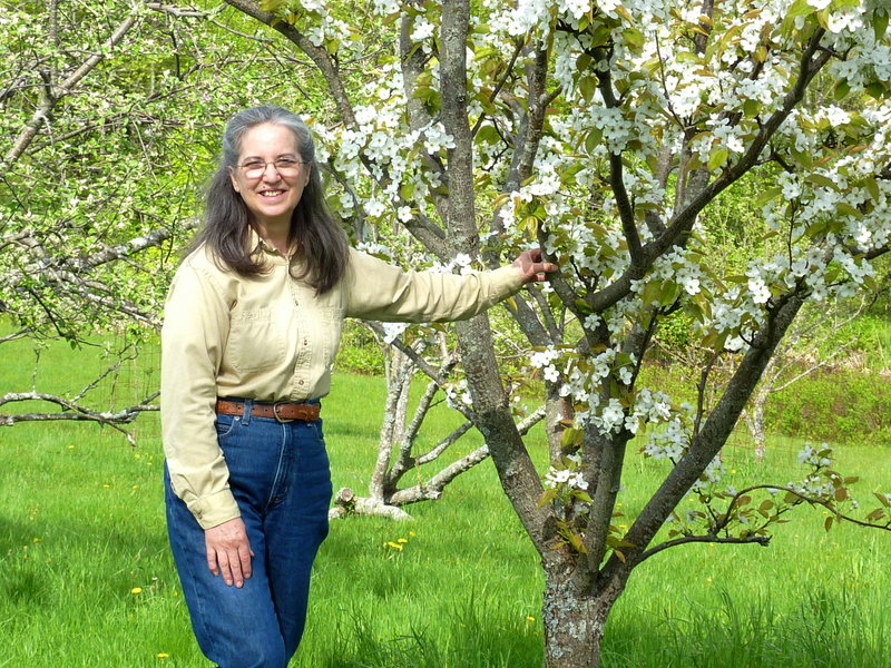 "Food preservation expert Ana Antaki poses in her orchard at Weeping Duck Farm in Montville. Antaki will deliver the talk ""Preserving the Harvest with Dehydration"" at 7 p.m. Thursday at Camden Public Library."