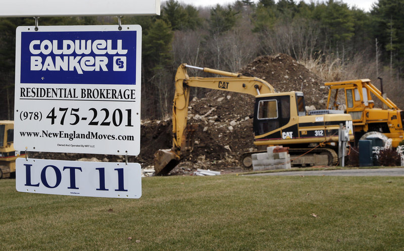 A sign hangs in North Andover, Mass., where a house was under construction during December.