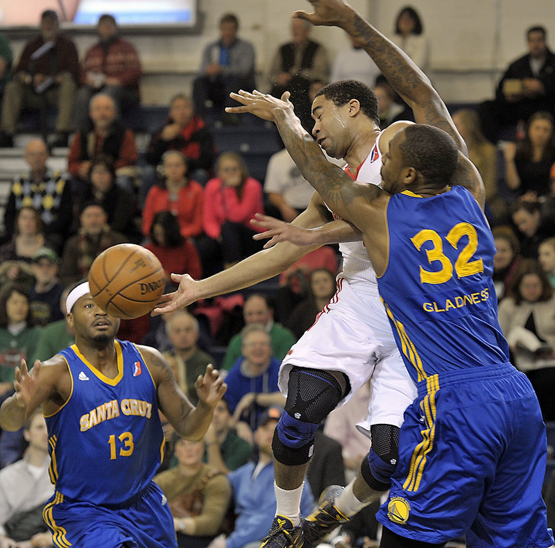 Maine's Andre Barrett finds himself surrounded by Warriors Mickell Gladness (32) and Stefhon Hannah (13) during Friday's loss to Santa Cruz.
