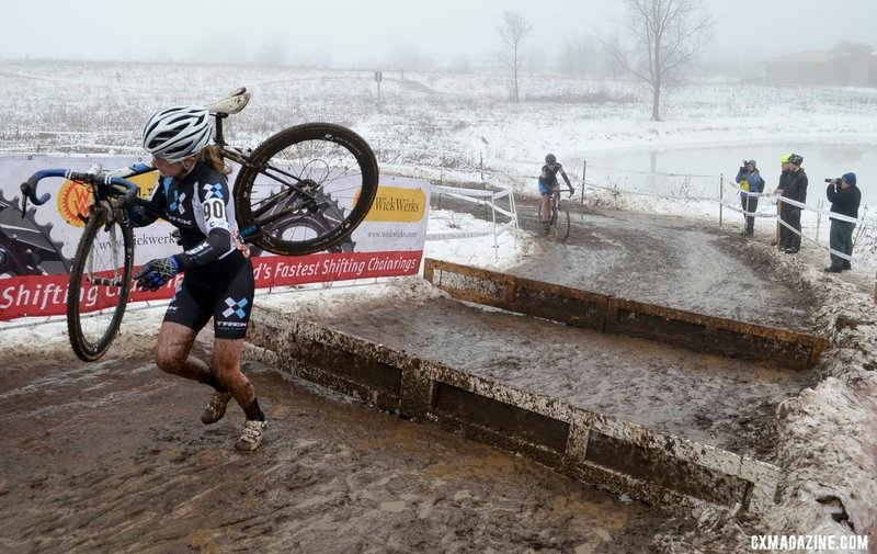 Ellen Noble carries her bike over an obstacle at the USA Cycling Cyclo-cross Nationals in Wisconsin on Jan. 11.