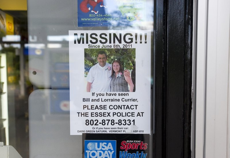 A poster seeking information about Bill and Lorraine Currier of Essex, Vt., hangs in the window of the Richmond, Vt., Mobil station in 2011. Israel Keyes is suspected of killing the couple.