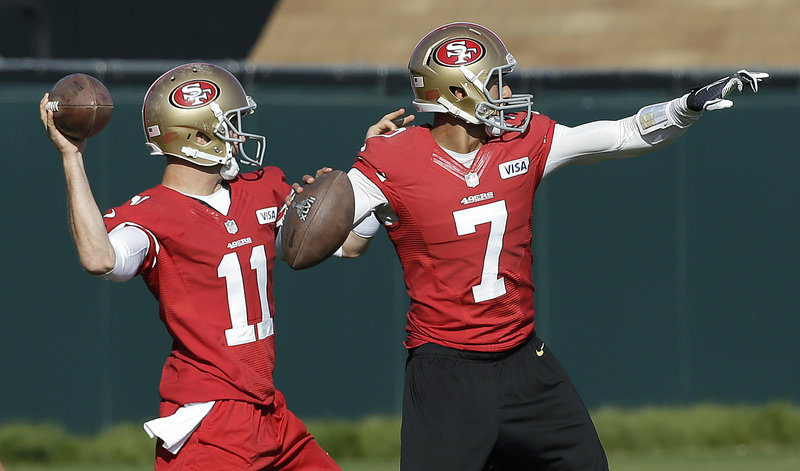 Alex Smith, left, and Colin Kaepernick, the starter, have the arms to test the Baltimore Ravens' secondary and help provide a championship for the San Francisco 49ers.