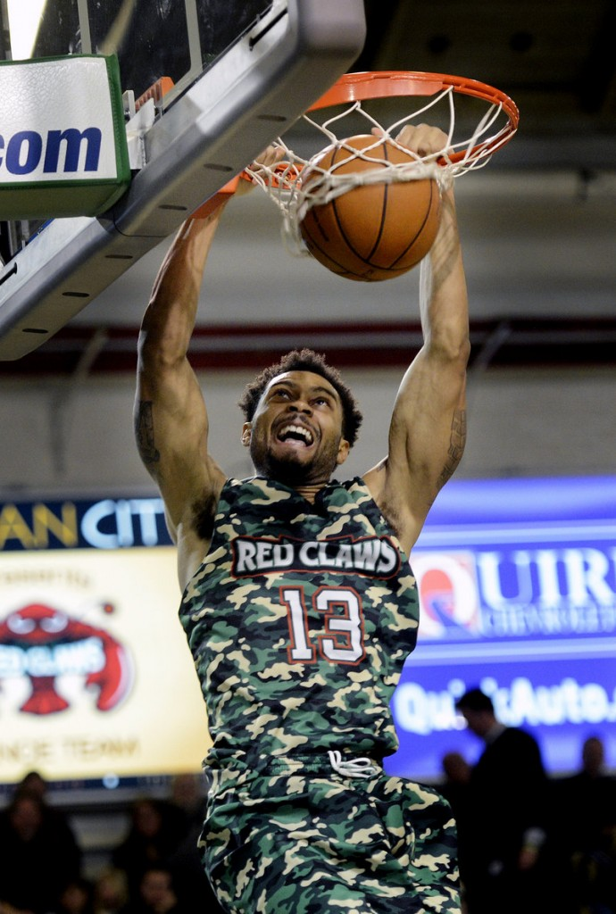 Maine guard Xavier Silas puts home dunk in the Red Claws' 120-112 win over Springfield on Sunday. Silas scored 24 points, second on the team behind Chris Wright's 25.
