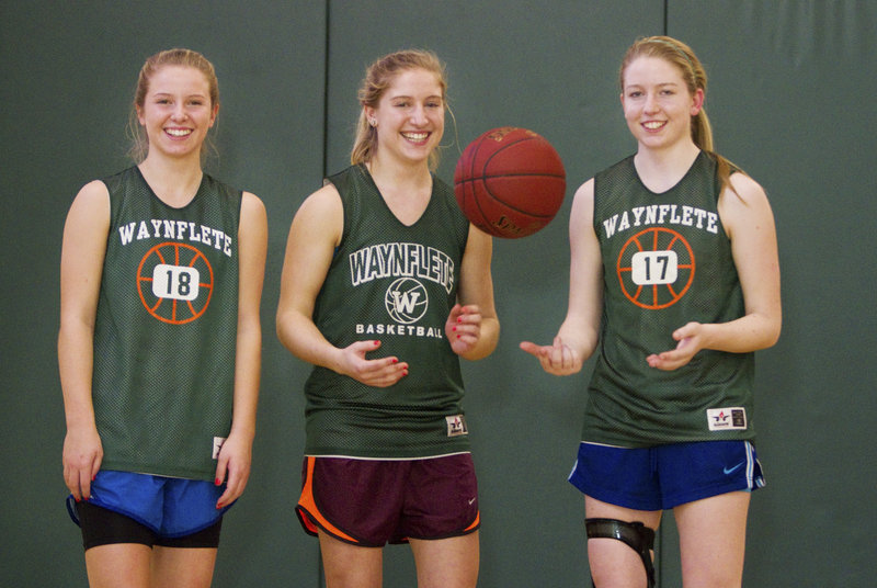 This year there are three Veroneaus playing girls' basketball for Waynflete – freshman Anne, left, and the senior twins, Martha, center, and Catherine. And a state title is possible.