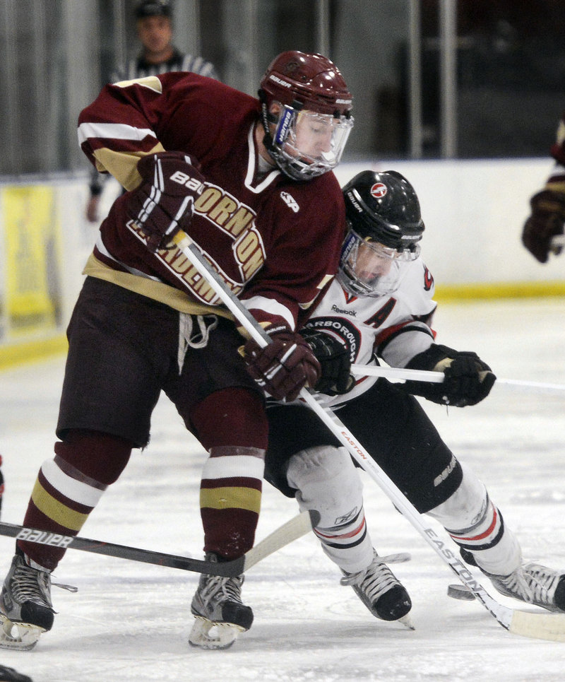Ben Bragg, right, of Scarborough battles with Thornton Academy's Stephen Comar during Scarborough's 4-3 win at Saco on Monday afternoon. The Red Storm improved to 12-1.