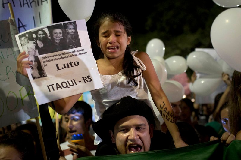 A girl cries during a march in a plaza near the Kiss nightclub honoring the victims of Sunday's fatal fire inside the club in Santa Maria, Brazil, on Monday.