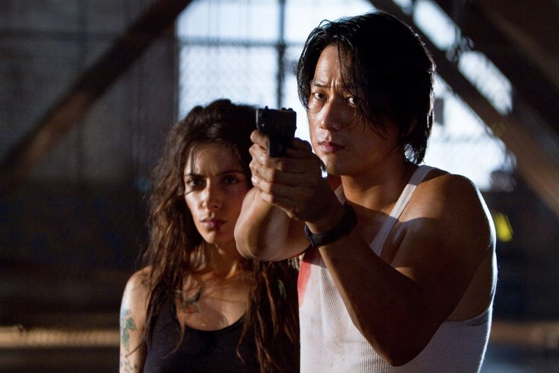 Sarah Shahi and Sung Kang in director Walter Hill's return to the buddy-cop genre.