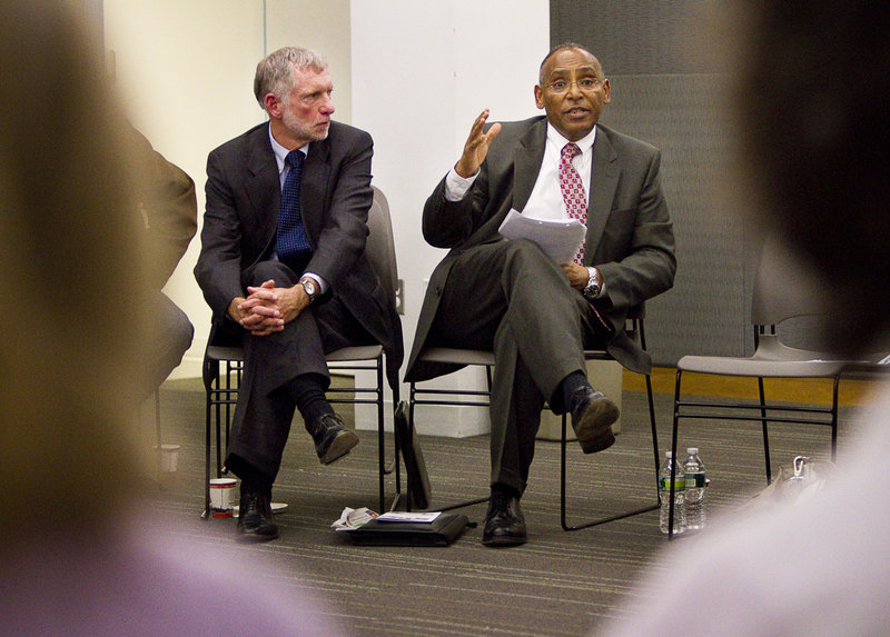 Eskinder Negash, right, the director of the federal Office of Refugee Resettlement addresses a meeting at the Portland Public Library. He was accompanied by Larry Bartlett, another federal refugee official.