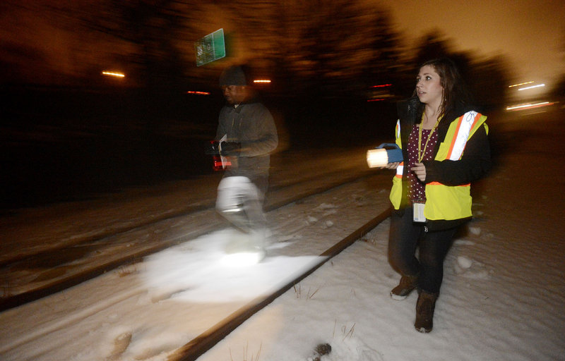 Harrison Deah, a supervisor with the Oxford Street Shelter, and Sara Fleurant, of the shelter's housing council, search for homeless people along the railroad tracks behind Deering Oaks park in Portland on Wednesday.