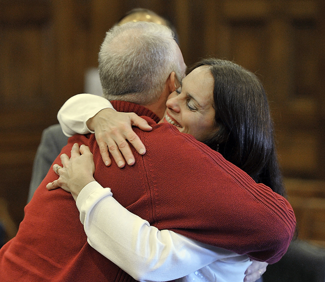 On Thursday, Feb. 07, 2013, Barry and Paula Spencer hug with joy after hearing the jury was deadlocked with the verdict resulting in a mistrial. Like the jury, public opinion on the case is split.
