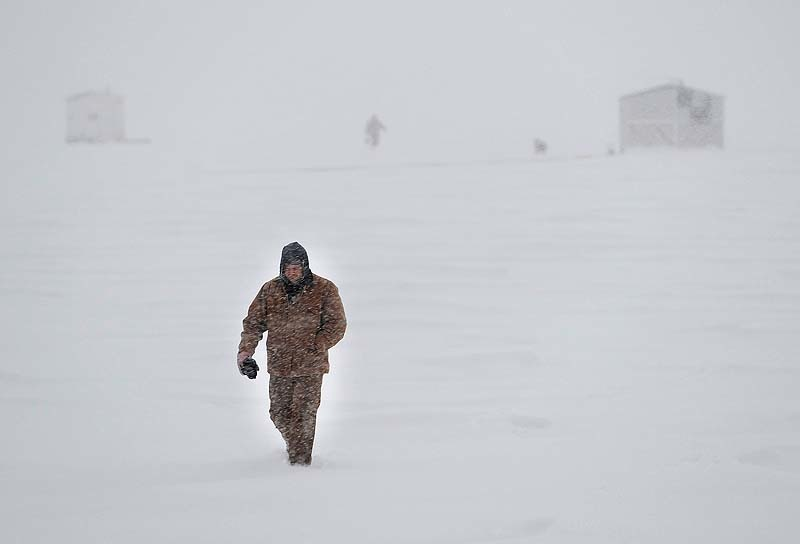 Icefisherman Ken Booth of Hollis is walking to his truck in near white-out conditions, but will return to his shack on Sebago Lake for an all-night fishing expedition during a massive blizzard on Friday, Feb.8, 2013. Storm3