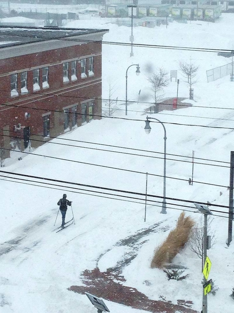 An unidentified person skis down the deserted streets of Portland between Planet Fitness and Walgreens on Saturday, Feb. 9, 2013.