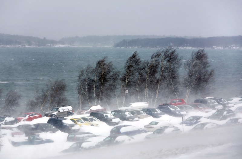 Cars are parked along the Eastern Promenade due to the Portland parking ban during a blizzard in Portland Saturday morning on February 9, 2013.