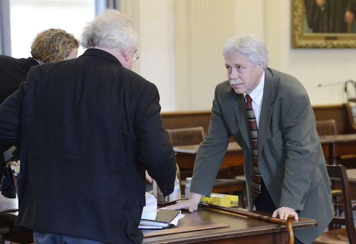 Defendant Mark Strong Sr., right, talks with his attorney Daniel Lilley after a hearing Tuesday morning in York County Superior Court.