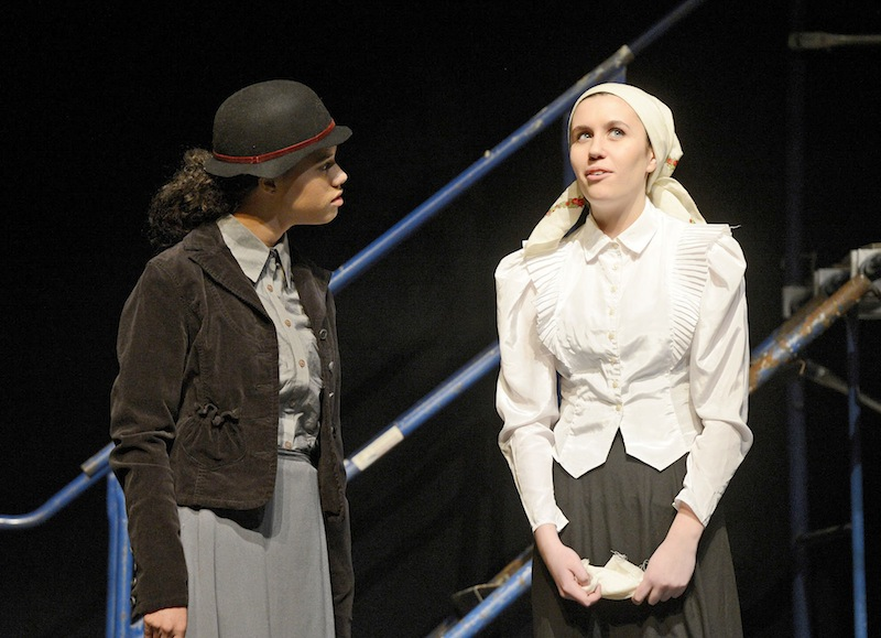 Rachel Doering and Natalie Veilleux portray factory workers during rehearsal at Deering High School for the oce-act play
