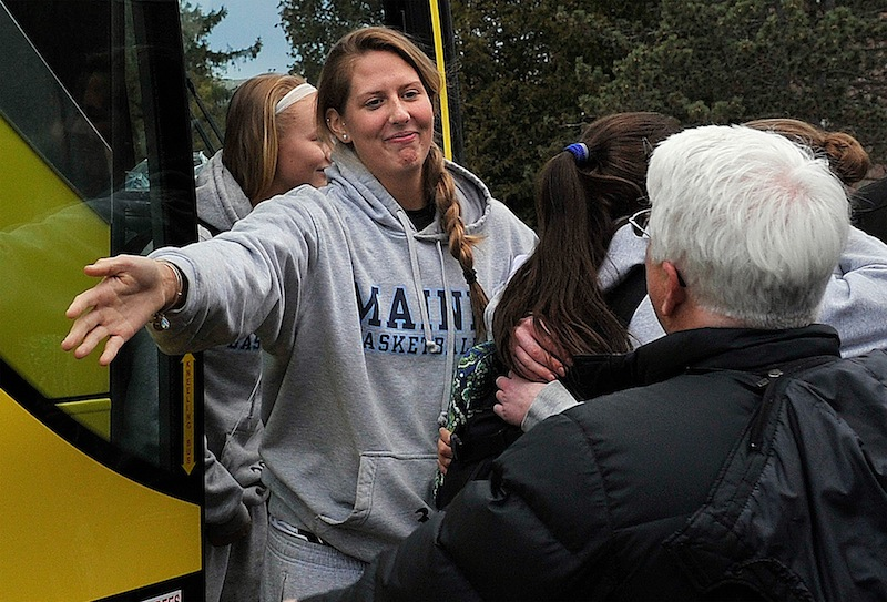 The University of Maine women's basketball team returned to Orono on Wednesday evening, Feb. 27, 2013, after being involved in a harrowing crash on I-95 in Massachusetts on Tuesday night.