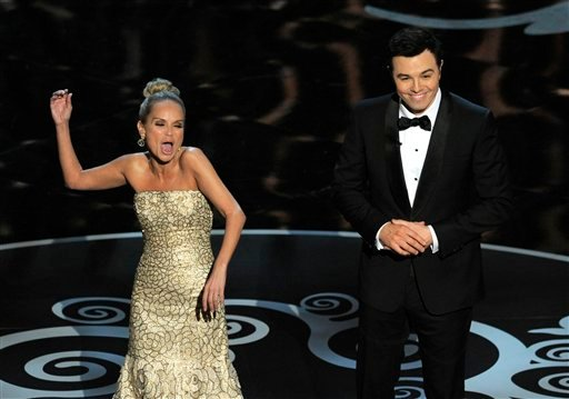 Host Seth MacFarlane and actress Kristin Chenoweth perform a song dedicated to the