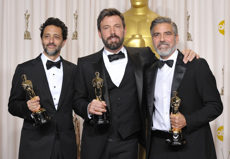 Grant Heslov, from left, Ben Affleck, and George Clooney pose with their award for best picture for