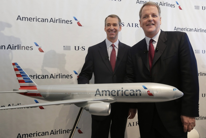 US Airways CEO Doug Parker, right, and American Airlines CEO Tom Horton pose at DFW International Airport on Thursday in Grapevine, Texas.