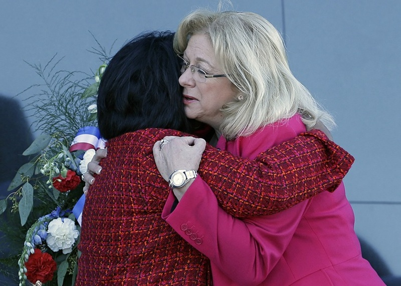 Space shuttle Columbia widows Sandra Anderson, left, and Evelyn Husband-Thompson embrace during a ceremony on the 10th anniversary of the disaster.