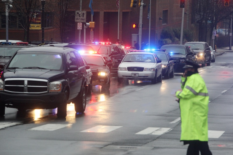 Police cars fill the street outside the New Castle County Courthouse, Monday morning, Feb. 11, 2013 in WiIlmington, Del. , after a man killed his estranged wife and two others at the courthouse. The mayor of Wilmington says police have killed the gunman. (AP Photo/The News Journal/William Bretzger) courthouse shooting
