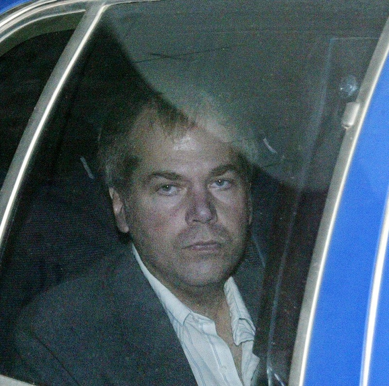 In a Nov. 18, 2003 file photo, John Hinckley Jr. arrives at U.S. District Court in Washington. Hinckley, the man who shot President Ronald Reagan is back in court for hearings on whether he should get to spend more time away from the psychiatric hospital where he has been living. (AP Photo/Evan Vucci, File)