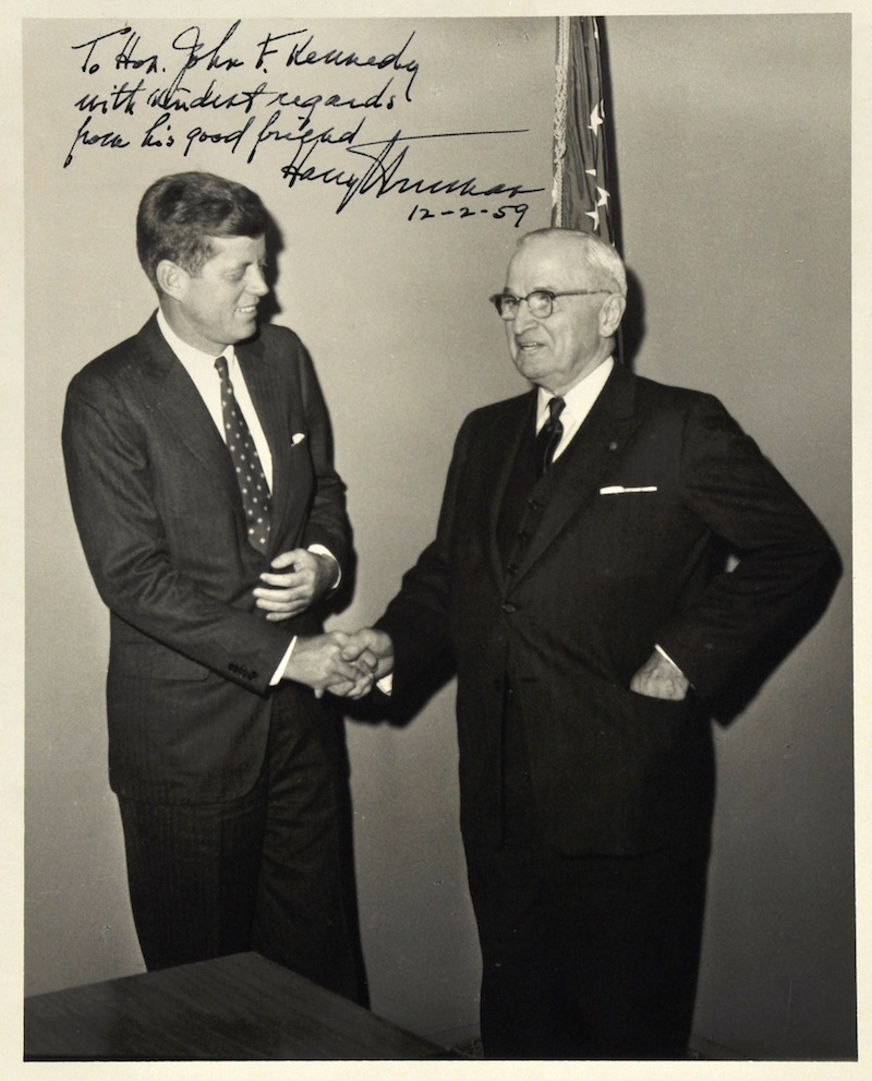 This undated file photo provided by John McInnis Auctioneers shows a photograph of late Presidents John F. Kennedy, left, and Harry Truman, signed by Truman on Dec. 2, 1959. The photograph is part of a collection of John F. Kennedy memorabilia from the family of David Powers, a former special assistant to the president, that fetched almost $2 million at auction Sunday, Feb. 17, 2013 at John McInnis Auctioneers in Amesbury, Mass. (AP Photo/John McInnis Auctioneers, File)