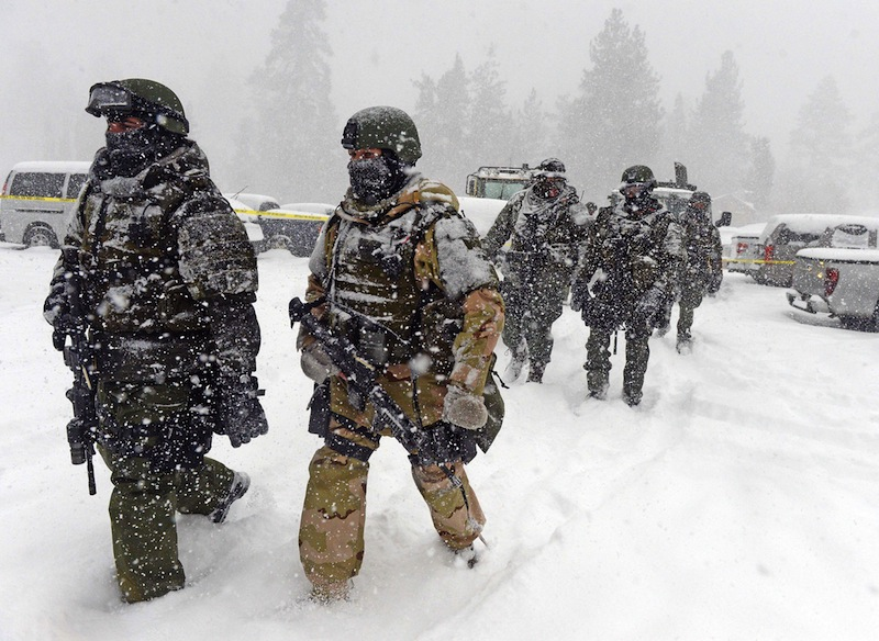 A San Bernardino County Sheriff SWAT team returns to the command post at Bear Mountain near Big Bear Lake, Calif. after searching for Christopher Jordan Dorner on Friday, Feb. 8, 2013. Search conditions have been hampered by a heavy winter storm in the area. Dorner, a former Los Angeles police officer, is accused of carrying out a killing spree because he felt he was unfairly fired from his job. (AP Photo/Pool, The Inland Valley Daily Bulletin, Will Lester)