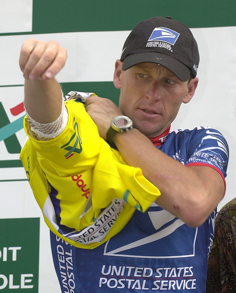 In this June 14, 2003 file photo, U.S. Postal Service leader Lance Armstrong puts on the overall leader's yellow jersey after the 6th stage of the 55th Criterium du Dauphine Libere cycling race between Challes Les Eaux and Briancon, French Alps. Lawyers for Armstrong say the Justice Department has joined a lawsuit against the cyclist. The lawsuit alleges the former Tour de France champion concealed his use of performance-enhancing drugs for over a decade and defrauded his long-time sponsor, the U.S. Postal Service. (AP Photo/Patrick Gardin, File) SPORTS