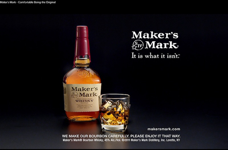 This file still frame image made from video provided by Maker's Mark Distillery Inc., shows a bottle of Maker's Mark in an advertisement. The producer of Maker's Mark bourbon is cutting — likely permanently — the amount of alcohol in each bottle to stretch every drop of the famous Kentucky whiskey. The alcohol volume is being lowered from its historic level of 45 percent to 42 percent — or 90 proof to 84 proof. (AP Photo/Marker's Mark Distillery Inc., File)