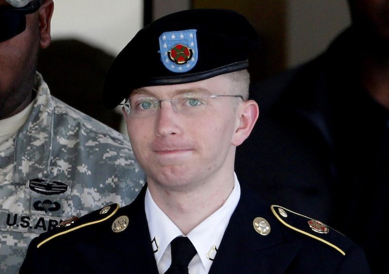 In this June 25, 2012 file photo, Army Pfc. Bradley Manning, right, is escorted out of a courthouse in Fort Meade, Md. The Army private charged in the largest leak of classified material in U.S. history says he sent the material to WikiLeaks to enlighten the public about American foreign and military policy on Thursday, Feb. 28, 2013. (AP Photo/Patrick Semansky, File)