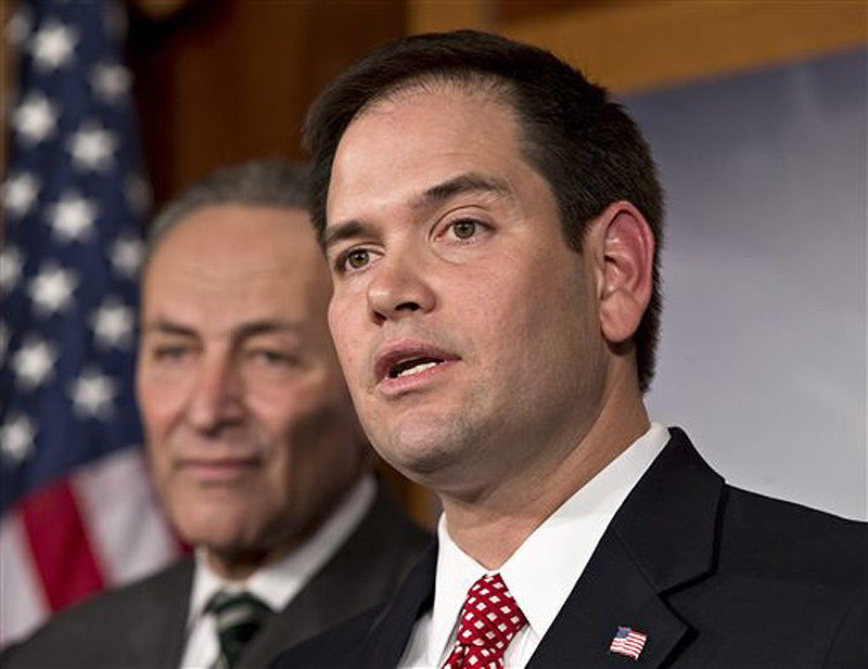 Sen. Marco Rubio, R-Fla., will deliver the Republican response to President Obama's State of the Union address on Tuesday. Behind him is Sen. Charles Schumer, D-N.Y.