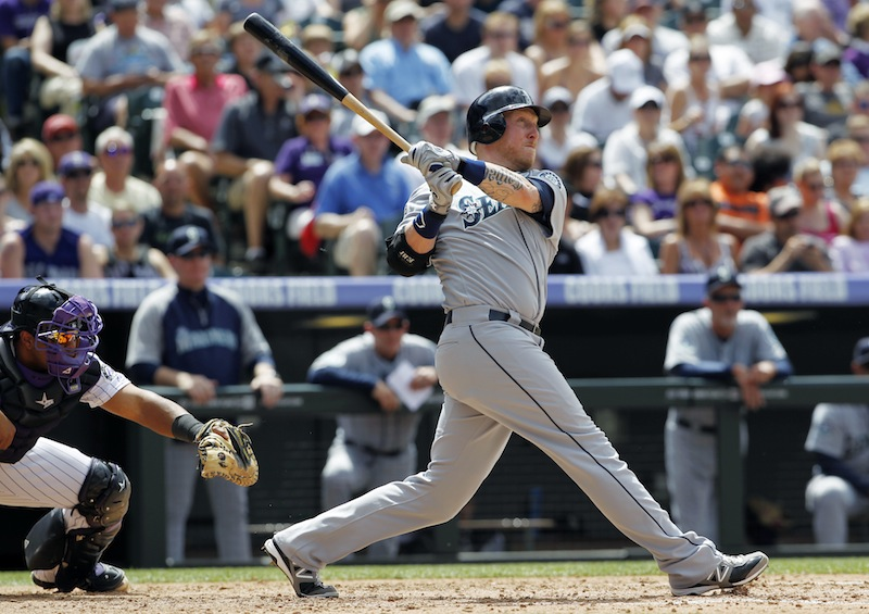 In this May 20, 2012, file photo, former Seattle Mariners' Mike Carp follows the flight of his solo home run. Carp is eager for his new start with his new team in a new season, and seems ready to finally forget the nightmare that was 2012. The Red Sox are hoping for big things. (AP Photo/David Zalubowski, File)
