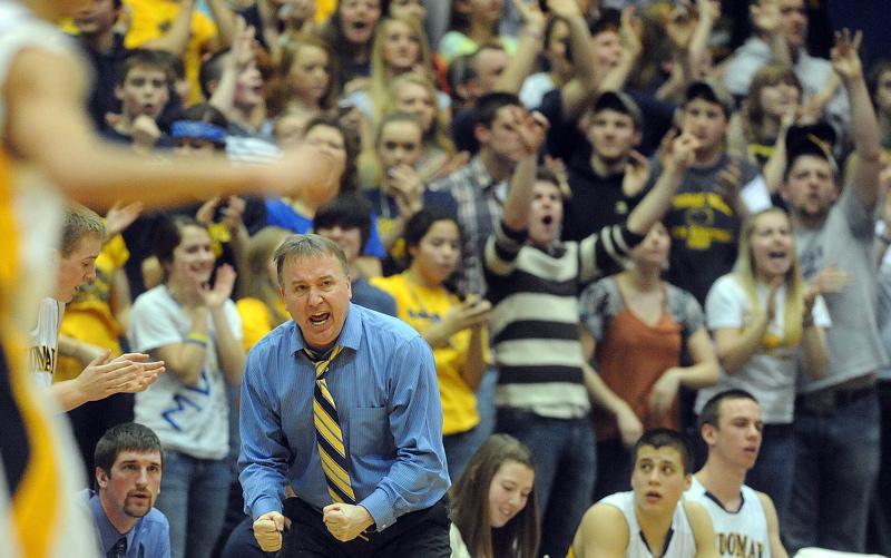 Medomak Valley Coach, Nicholas DePatsy celebrates a 3-point shot against MDI in the Eastern Class B championship game at the Bangor Auditorium Saturday.
