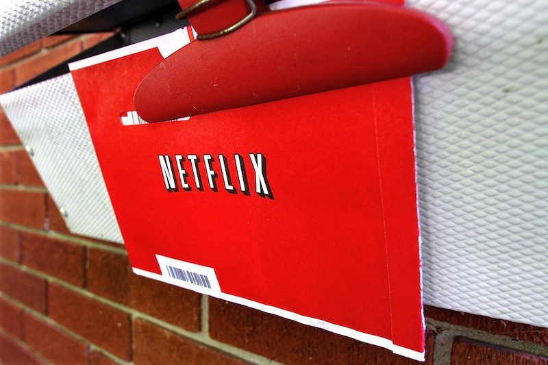 In this Thursday, Aug. 23, 2012, file photo, a Netflix envelop containing a DVD to be returned by mail is clipped onto a mailbox, in Springfield, Ill. Netflix won't miss Saturday mail delivery, even though the weekend service helped keep its DVD-by-mail subscribers happy. The U.S. Postal Service's planned shift to five days of home delivery a week instead of six may even make Netflix Inc. slightly more profitable. (AP Photo/Seth Perlman)
