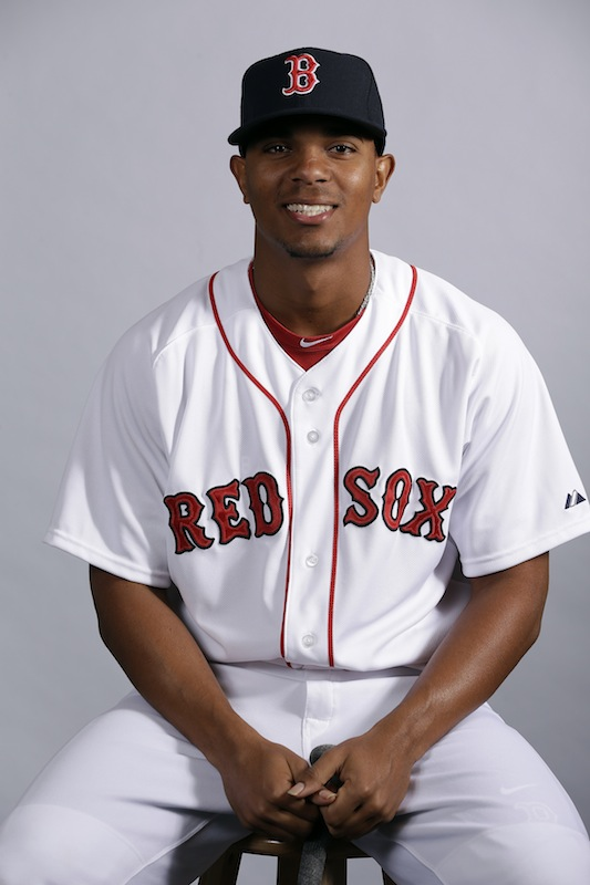 This Feb. 17, 2013 file photo shows Boston Red Sox's Xander Bogaerts posing during team photo day in Fort Myers, Fla. Bogaerts, Boston's top prospect, is chugging away at his first spring training, doing whatever he can to impress staff and teammates. Either way, though, he'll soon be headed out of town. (AP Photo/Chris O'Meara, File)