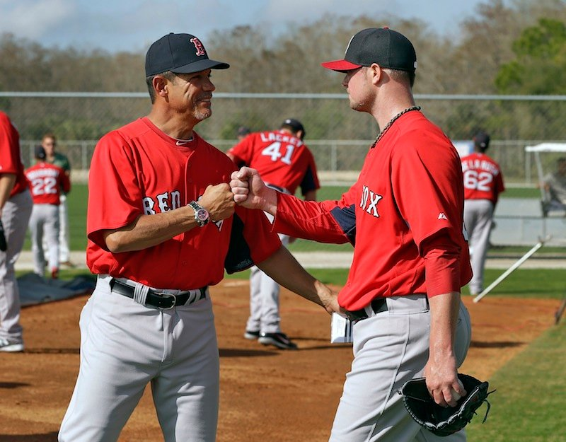 Boston Red Sox pitcher Jon Lester, right, gets a fist bump from pitching coach Juan Nieves after throwing a bullpen session at spring training Wednesday, Feb. 13, 2013, in Fort Myers, Fla. (AP Photo/Chris O'Meara)