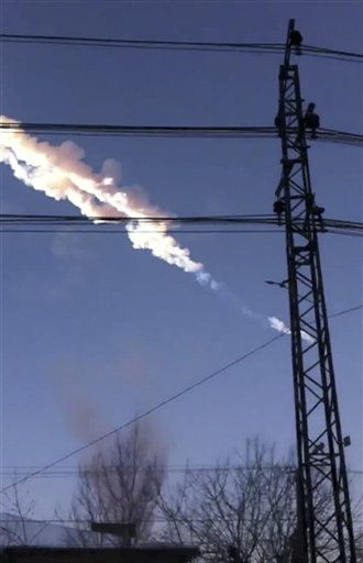 In this photo taken with a mobile phone camera, a meteorite contrail is seen in Chelyabinsk region on Friday.