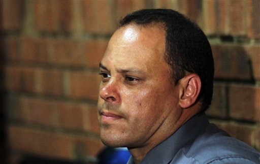 Former lead investigator Hilton Botha sits in the witness box during the bail hearing on Wednesday for Oscar Pistorius.
