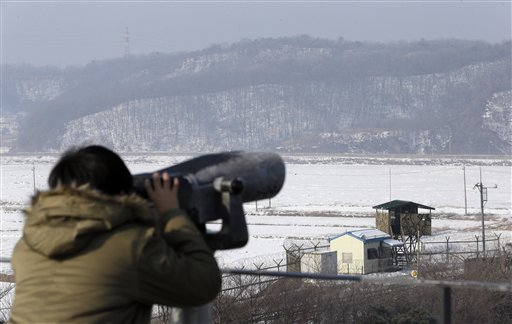 A visitor looks through binoculars Wednesday at Imjingak Pavilion near the border village of Panmunjom, which has separated the two Koreas since the Korean War. Defying U.N. warnings, North Korea on Tuesday conducted its third nuclear test in the remote, snowy northeast, taking a crucial step toward its goal of building a bomb small enough to be fitted on a missile capable of striking the United States.